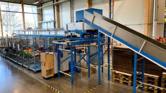 Bilden visar en fiberscanner, även kallad Fibersort, som använder NIR-teknologi för automatisk textilsortering, den enda i sitt slag i Norden