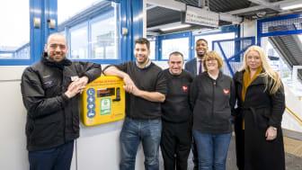 Tom Moran (far left), MD of Thameslink and Great Northern, announces the installation of life-saving defibrillators across Govia Thameslink Railway