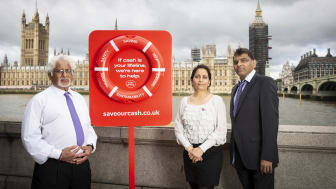 Naresh Patel (Branch Manager of Westminster Bridge Post Office), Bharti Patel (Postmaster at Churchill Place Post Office) and Subhash Patel (Postmaster at Canary Wharf Post Office) promoting 'Save Our Cash Day'