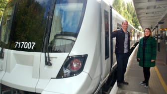 Driver Michael DeVries and passenger Samantha Radford at Gordon Hill on the first new Moorgate train in passenger service