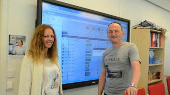 Seksjonsleder Cristina Eiksund og teamleder i hjemmetjenesten, Mijodrag Pilipovic, foran en Imatis-skjerm