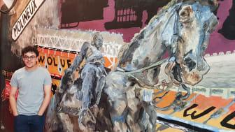 Student Coree Bridgen with his artwork at Wolverhampton station