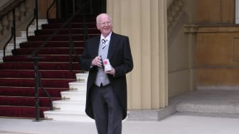 Alderman Tommy Nicholl pictured in 2006 at Buckingham Palace after being awarded the MBE. Ald Nicholl was presented with a special tribute recently to mark 40 years as a councillor in the Bannside area.
