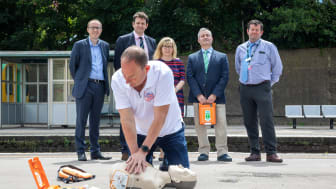 Resuscitation Trainer Steve Morris demos heart restarter to (l to r) Southern's Head of Safety Mark Whitley, Sussex Heart Charity (SHC) Trustees Chair Mike Lewis, Maria Caulfield MP,  SHC Vice-Chair Jason Palmer, Lewes Station Manager Andy Gardner