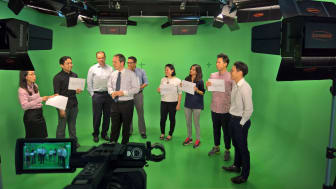 HBM's Mark Laudi and Communications Specialists on set at HBM's Kuala Lumpur studio