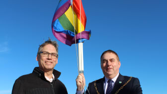Moray Council's Equalities Officer, Don Toonen, with Convener of Moray Council, Cllr James Allen raising the rainbow flag at council HQ