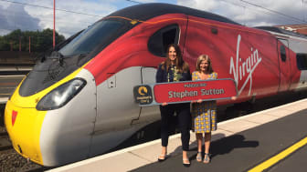 Jane receives her nameplate from the Virgin Trains team at Birmingham International