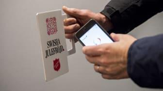 Kontantlös insamlingsbössa med Swish QR kod. Gåvan swishas enkelt och snabbt.