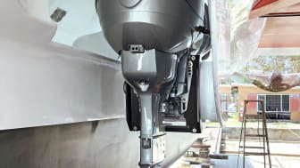 One of the YANMAR Neander Dtorque diesel outboards mounted mid-hull on sailing catamaran X-IT