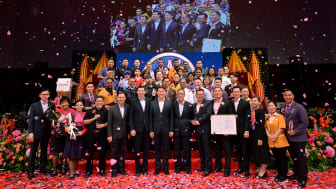 AAC 2019 award recipients celebrating their win with Minister Lam Pin Min