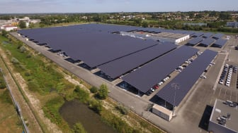 Coruscant rooftop solar park providing shade for cars and green energy for the electricity mix