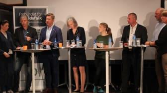 Fra venstre: Ordstyrer Stein Aabø,  Heidi Nodby Lunde (H), Ola Elvestuen (V), Terje Åsland (Ap), Elisabeth Gammelsæter (Norsk Bergindustri), Une Aina Bastholm (MdG), Roger Heimland (LO), Svein Oppegård (NHO), Anita Johansen (NAF)