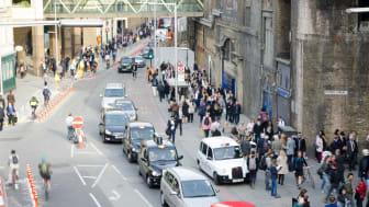 A street near London Bridge full of vehicles and pedestrians