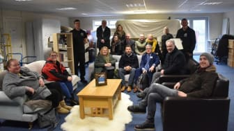 Steve Buckley from Manorview with ng homes volunteers and staff, Board member Richard porter, Rossie Stone from Dekko Comics and elected members Bailie Jaqueline McLaren, Councillor Allan Gow and Bob Doris MSP at the Redistribution Unit in Springburn