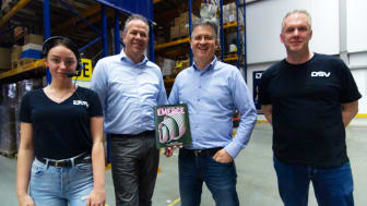 """We are very happy to receive the award"",  says customer relations manager, Erik Biemans.  Here pictured with Director, Ton Blom and DSV MCF employees in a DSV warehouse."