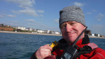 Roy Beal with the Ocean Signal rescueME PLB1 which he will carry on his 900-mile Top Down Kayak Challenge. Photo credit: Roy Beal
