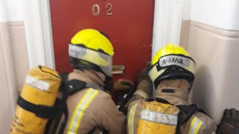 SFRS Firefighters prepare to enter the ng homes property