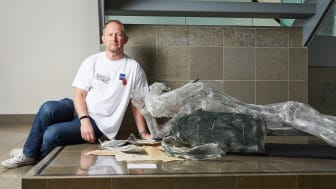 Stewart Hill with his sculpture, on show at Bury Art Museum