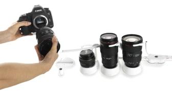 Självbetjänande varularm för kameralinser