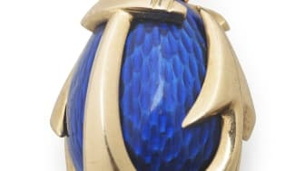 August Holmström: A Russian Easter egg pendant with blue translucent enamel on guilloched ground, set with anchor formed 14k gold cagework.