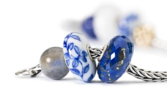 One of the new limited edition beads made in hand painted porcelain together with gemstones