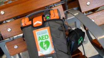 Defibrillators at every station - close up of defibrillator on station bench