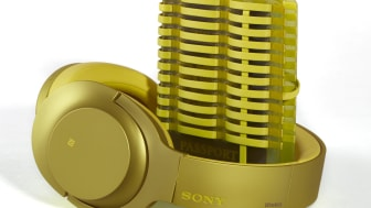 sony h.ear on yellow headphones with passport holder