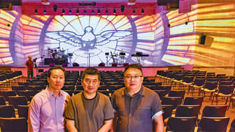 Jason Sim (centre), facilities and operations manager at Rock of Ages Services, turned to Epson projectors to project breathtaking visuals at a new auditorium in Eunos.