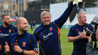 Essex Head Coach Chris Silverwood lifting the Specsavers County Championship trophy 2017