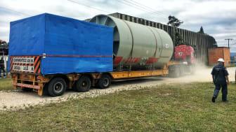 Heavy drum mill arrives at destination