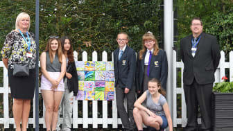 Head of Stations Angie Palmer and Station Manager David Hughes join students from Downham Market Academy who are displaying their art at the station (you can download more pictures below)