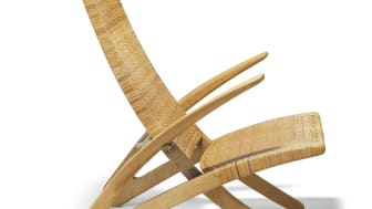 "Hans J. Wegner: ""Dolphin Chair"". Rare oak folding chair with seat and back of woven cane. Made by cabinetmaker Johannes Hansen. Estimate: DKK 400,000-500,000 / € 53,000-67,000."