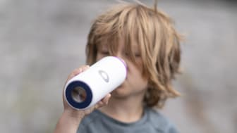 Encouraging children to drink from re-useable stainless steel bottles helps end the need for single-use plastic bottles, most of which end up as microplastics in our oceans (Photo Credit: Trygg)