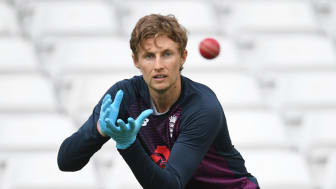 England Test captain Joe Root practising wearing disposable gloves during a training session at Trent Bridge as part of England's return to training protocols. (Getty Images)