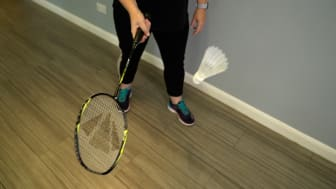 Charlotte, 48 from Hampshire, playing badminton