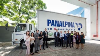 Thumbs up for greener transport: Panalpina and L'Oréal staff with the 24ft biodiesel truck. (Photo: Panalpina)