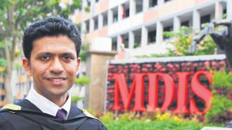 Tenacity earns him an MBA.