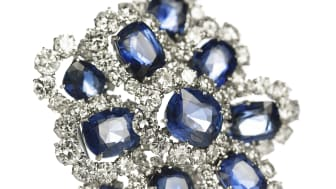 Van Cleef & Arpels: A sapphire and diamond brooch. Sold for EUR 97,500 / USD 107,000 (including buyer's premium).