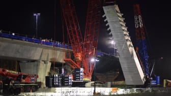 Sydney Metro skytrain bridge tower installation at night. Picture from Sydney Metro.