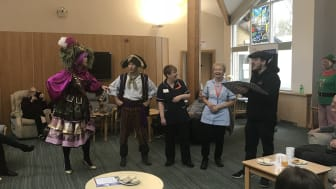 ellenor nurses playing pirates Swash and Buckle, directed by producer Tom (far right)