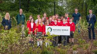 Pictured is the pupils from Woodburn Primary School receiving their compost.