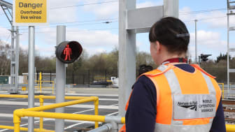 Brent Cross West: Network Rail Mobile Operations Manager Michelle Gull at new work-site level crossing