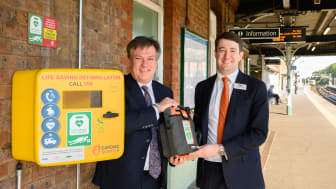 Defibrillators at every station - pictured at Three Bridges station with local MP