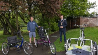 Mid and East Antrim Borough Council Sports Development Officer, Colin Roden, shows Mayor, Councillor Peter Johnston, some of the Inclusive Cycles.