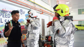 Students learning how to suit up quickly for fire-fighting training