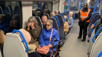 Members of local community group DR96 ride a Thameslink train to St Pancras with station staff. A high resolution version of this picture is available at the bottom of this page