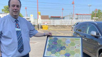 Station booking office clerk Darrell Gardiner is delighted with the new bee garden which features this information board (more pictures below)