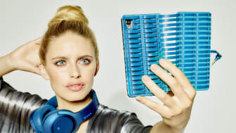h.ear on blue headphones with phone case
