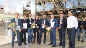 Vinnarna av Glaspriset 2018 fr v Erik Sällström, Lerstenen, Niklas Carlén, Wingårdhs, Pilutaq Larsen Ström, Semrén & Månsson, Tord-Rikard Söderström, Wingårdhs, Peter Forsberg, Lerstenen, Artis Baumanis, Arturas Kvauka och Normunds Ermanssons, UPB.