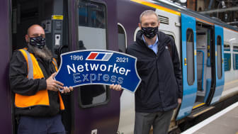 Driver Paul French (left) and Route Operations Assurance Manager Steve Castle proudly hold the headboard ahead of the last Class 365 out of King's Cross